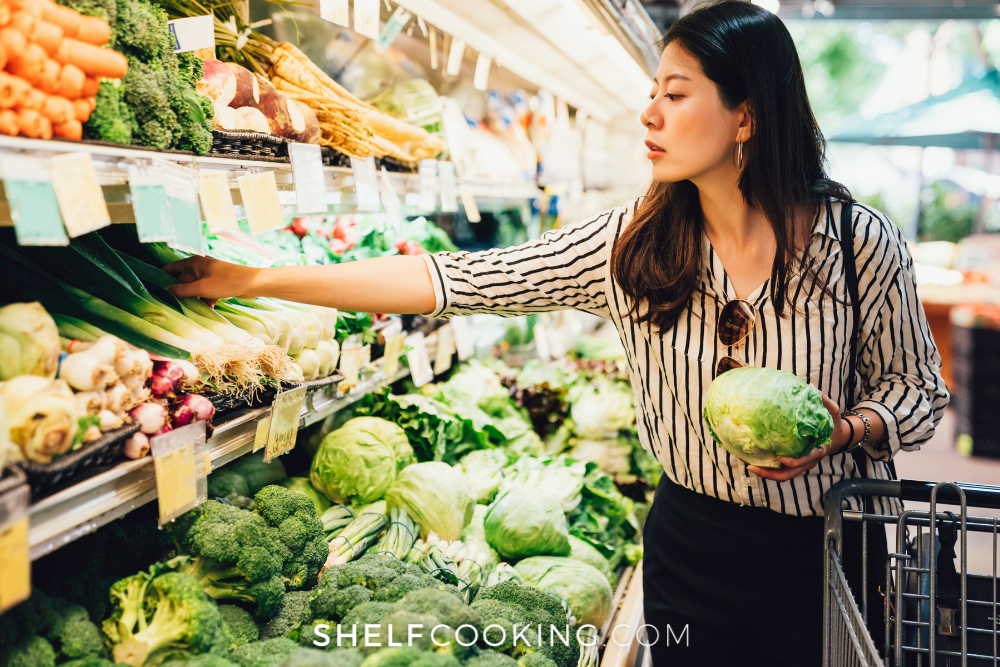 woman at the grocery store shopping for seasonal produce, from Shelf Cooking