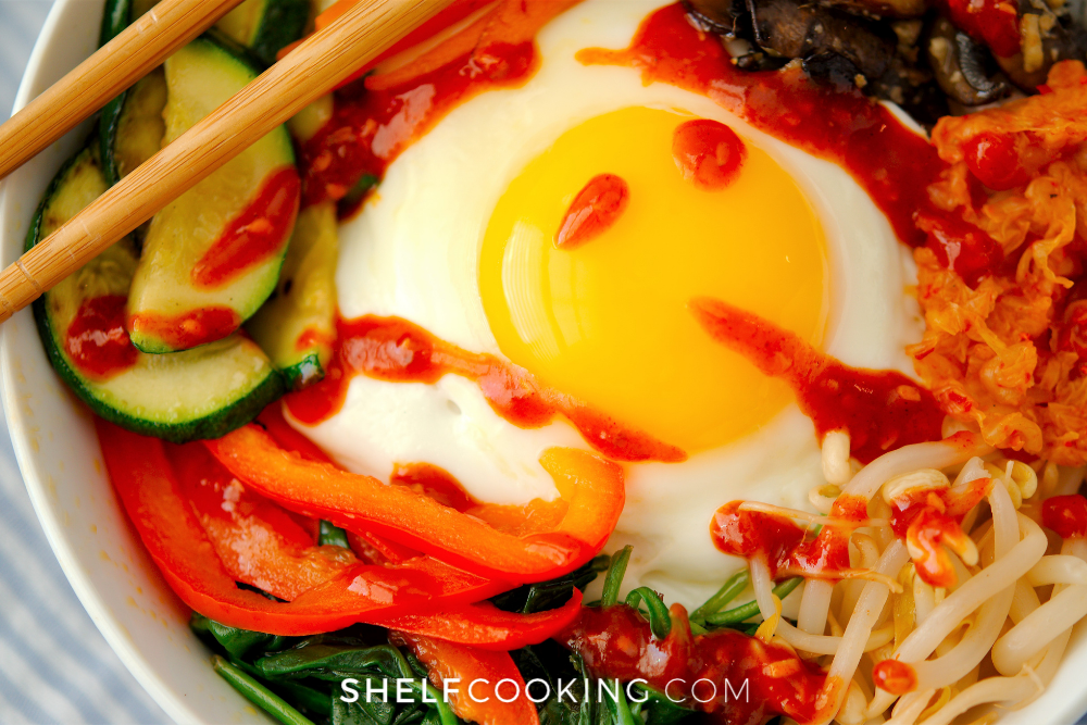 a closeup picture of a bowl of bibimbap, from Shelf Cooking
