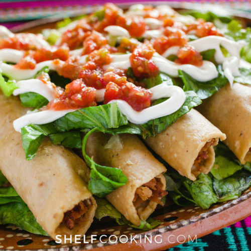 homemade chicken taquitos with toppings, from Shelf Cooking