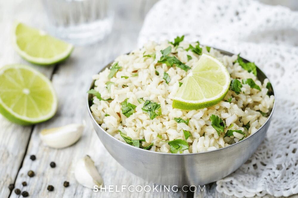 a bowl of Cafe Rio copycat cilantro lime rice, from Shelf Cooking