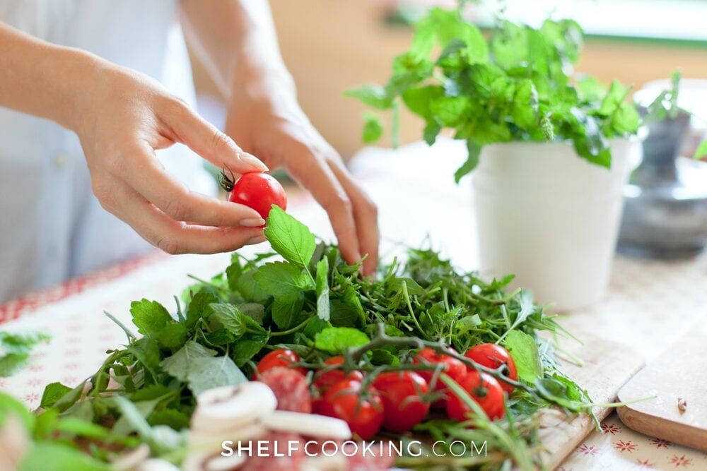 woman washing and prepping fresh veggies, from Shelf Cooking