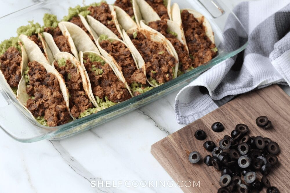 sliced black olives next to tacos, from Shelf Cooking
