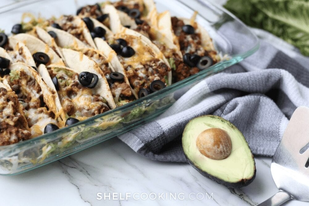 baked tacos topped with olives, from Shelf Cooking