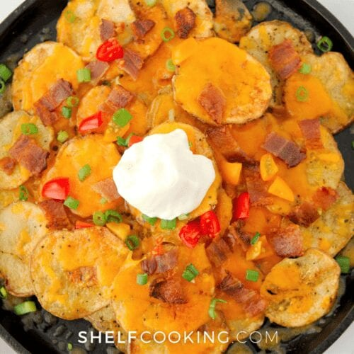 a plate of loaded sliced baked potatoes nachos, from Shelf Cooking