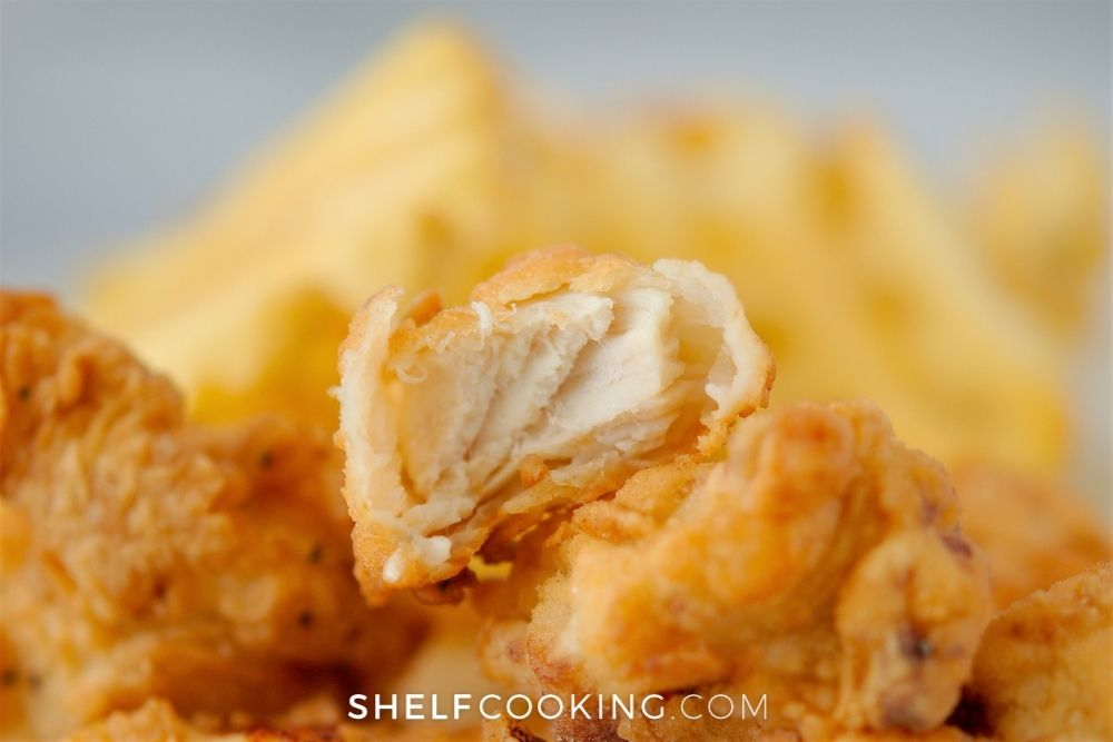 bite of a copycat chick-fil-a nugget, from Shelf Cooking