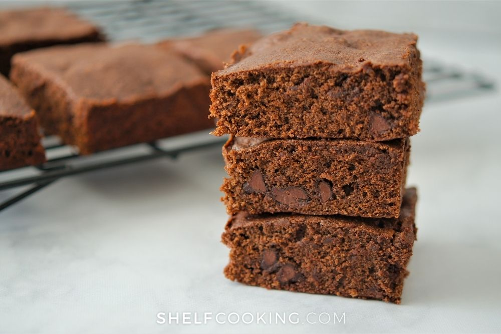 three fudge brownies stacked, from Shelf Cooking