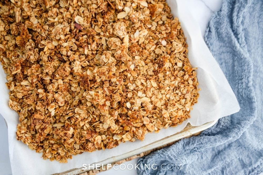 homemade granola fresh from the oven, from Shelf Cooking