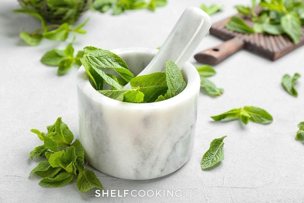 muddling fresh mint, from Shelf Cooking