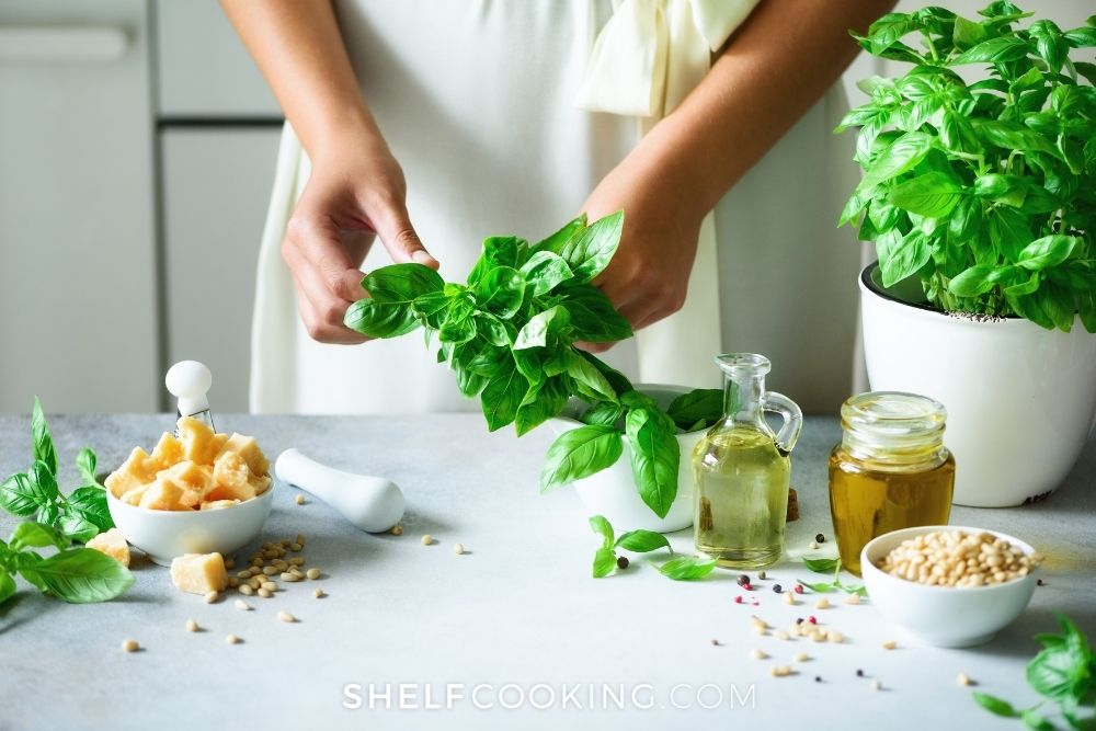 woman sorting herbs in kitchen, from Shelf Cooking