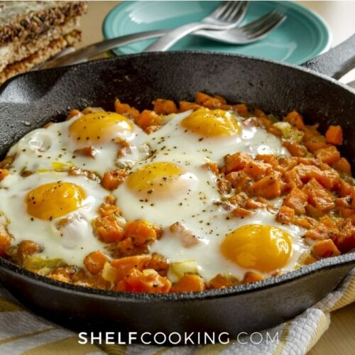 skillet of sweet potato hash with eggs, from Shelf Cooking