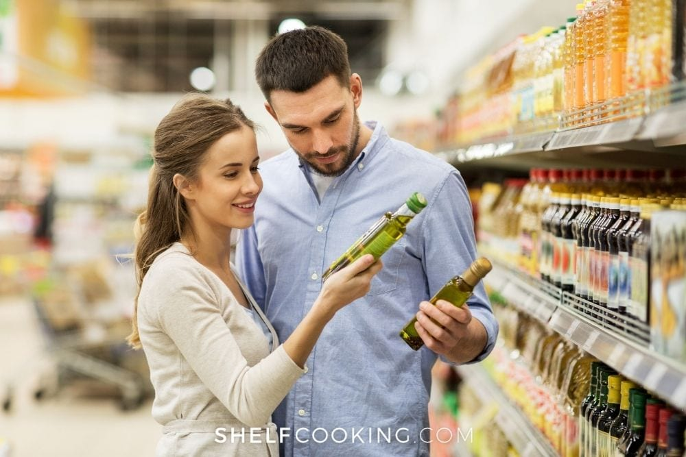 couple comparing products at grocery store, from Shelf Cooking