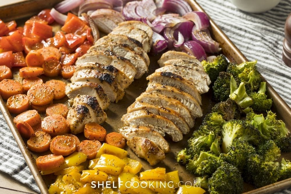 Chicken and veggies on a sheet pan for easy sheet pan recipes from Shelf Cooking.