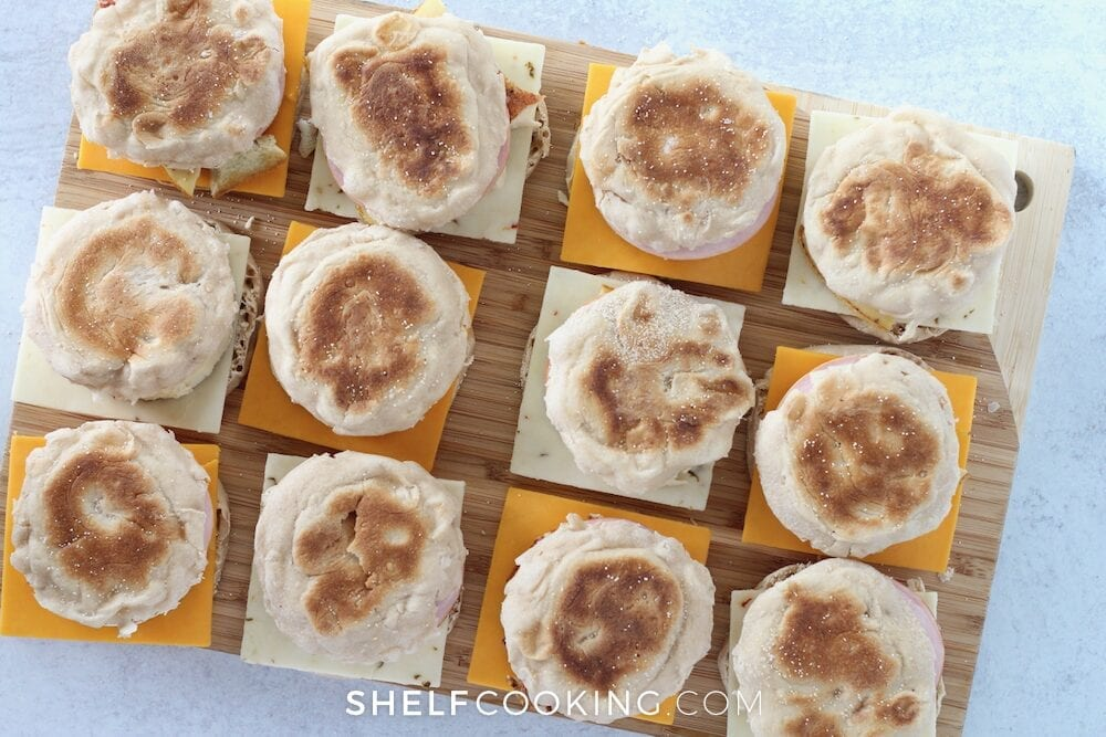 Make-ahead egg and cheese sandwiches on a wooden tray from Shelf Cooking.
