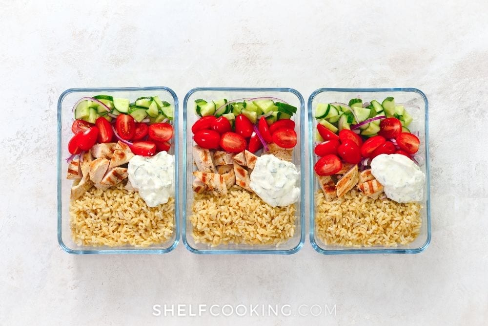 Chicken and rice with tomatoes and cucumbers for cheap meal prep ideas from Shelf Cooking.