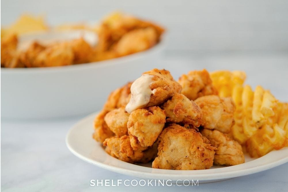 homemade Chick-fil-A sauce on a nugget, from Shelf Cooking