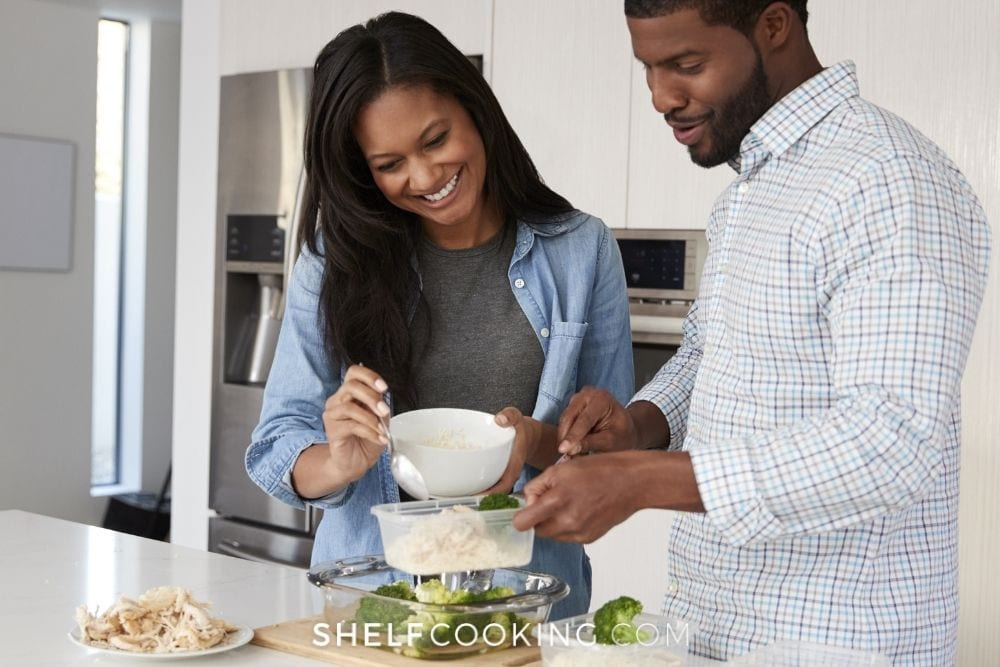 Couple doing weekly meal prep together with rice and broccoli from Shelf Cooking.