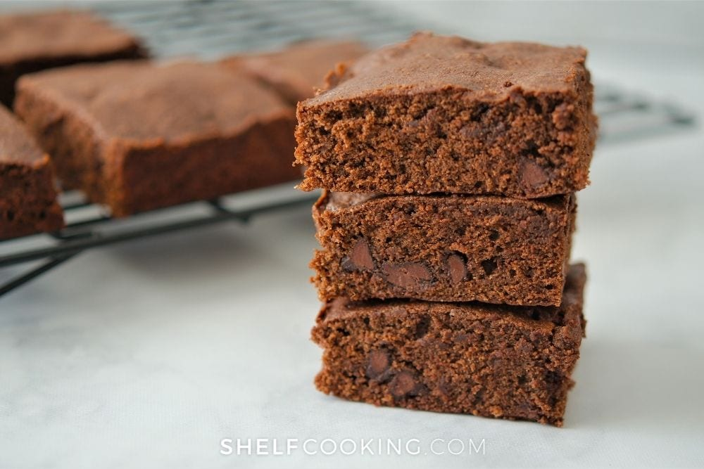 Brownies stacked on the counter from Shelf Cooking.