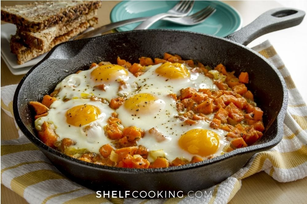 Sweet potato hash and egg in a cast iron skillet from Shelf Cooking.
