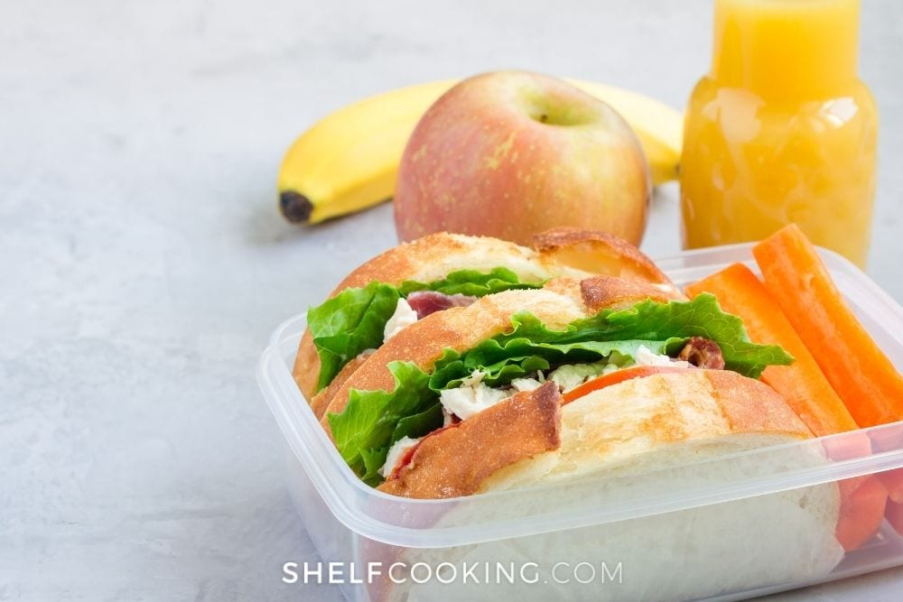 Food storage container with sandwich inside for weekly meal prep from Shelf Cooking.