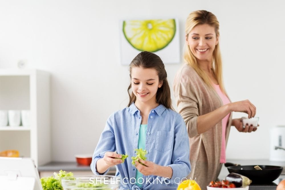 Mother and daughter working on meal prep together from Shelf Cooking.