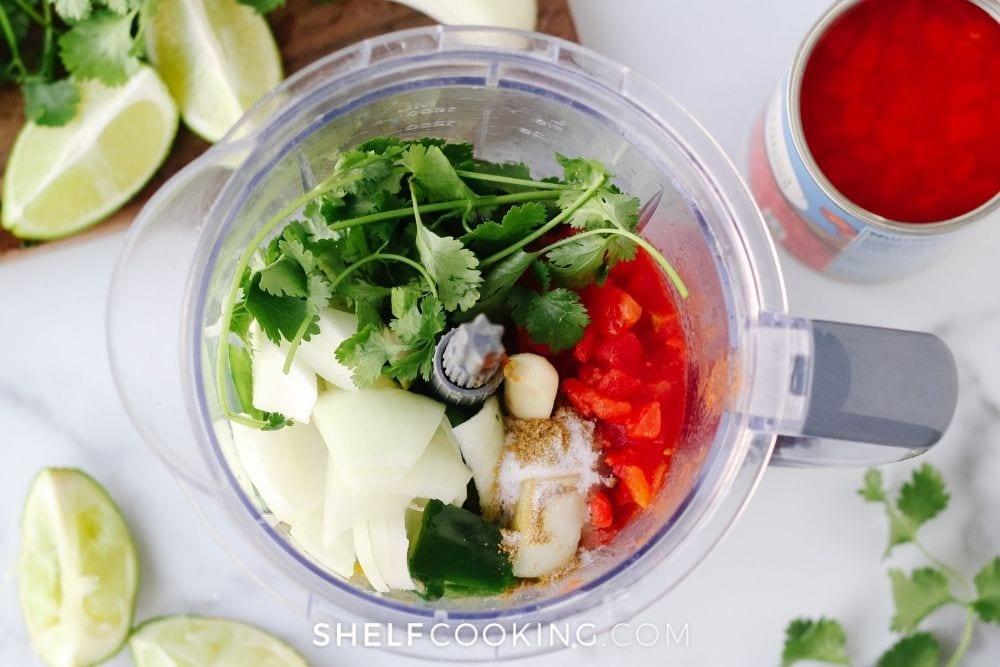 Blender full of homemade salsa ingredients from Shelf Cooking.