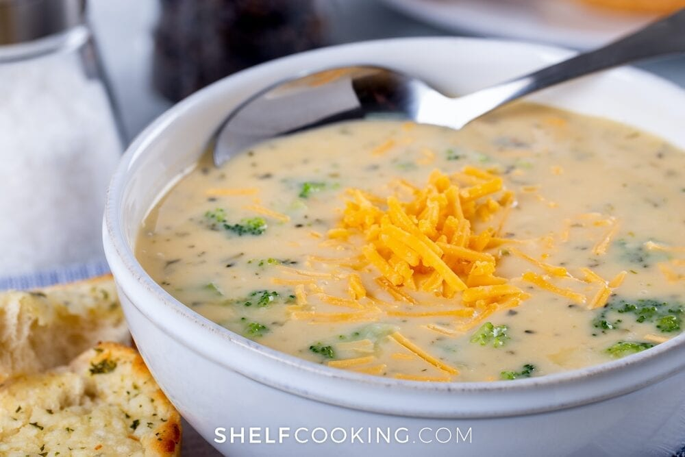 Bowl of broccoli cheddar soup from Shelf Cooking.
