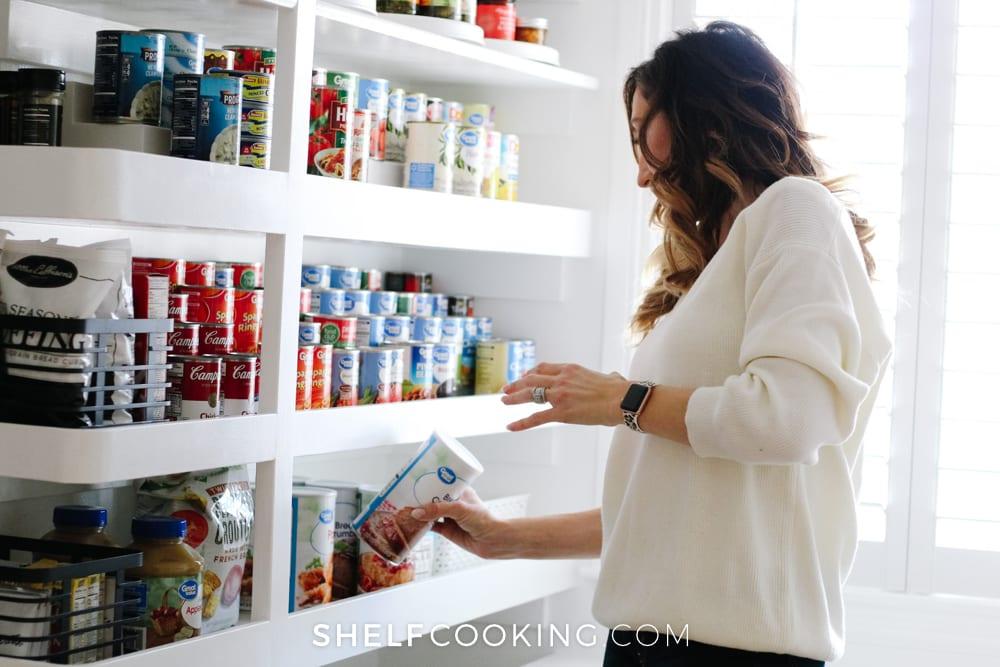 Jordan choosing case lot sale items, from Shelf Cooking