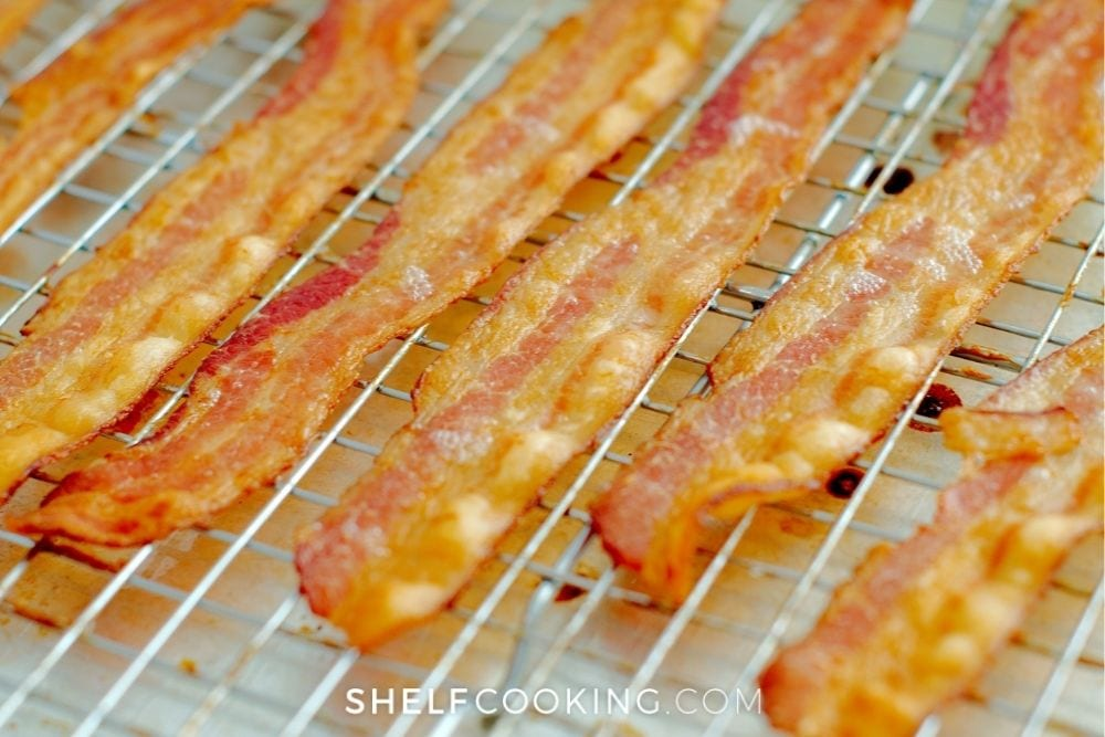 Cooked bacon on a baking sheet from Shelf Cooking.
