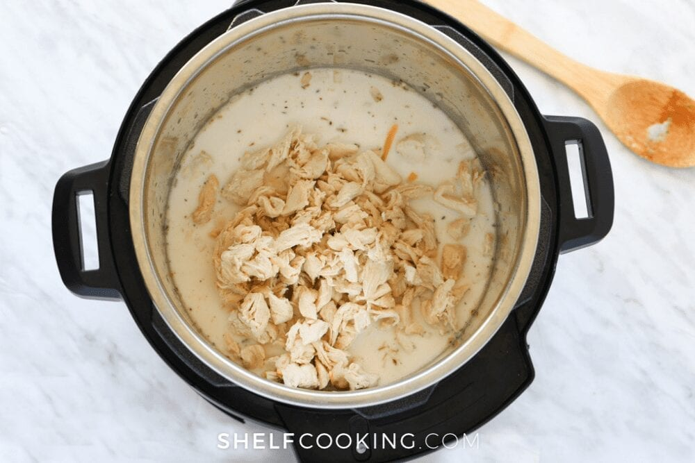 Instant pot with chicken Alfredo inside from Shelf Cooking.