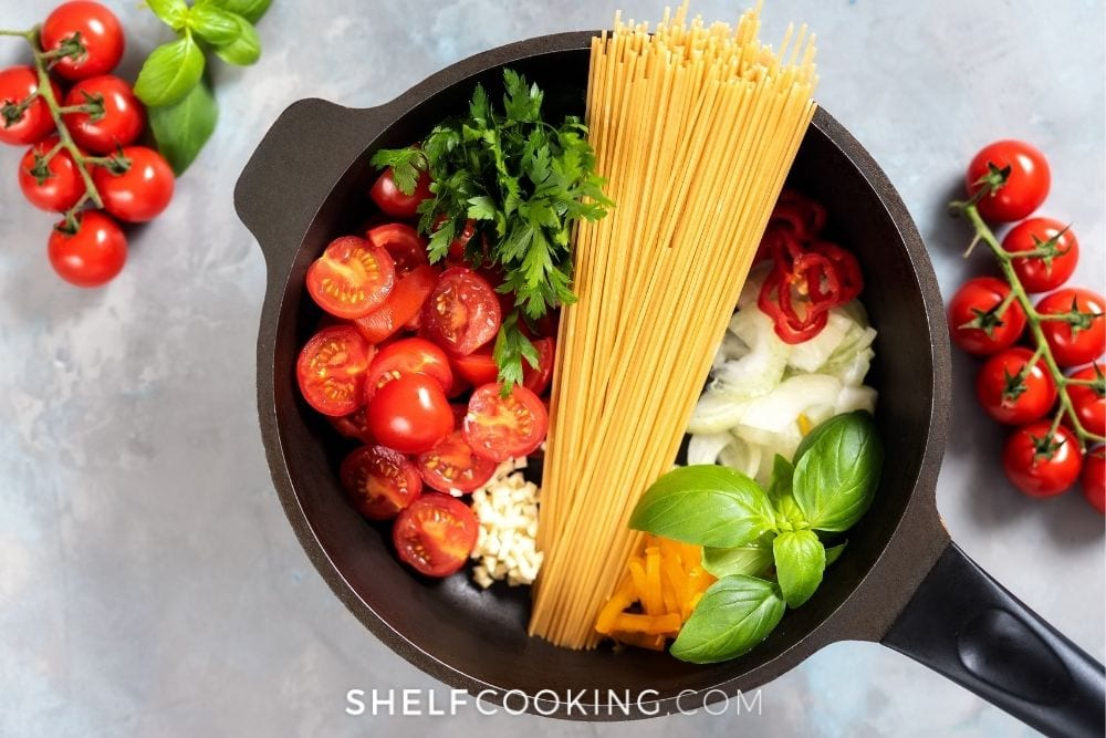 Pasta ingredients inside cast iron skillet from Shelf Cooking.
