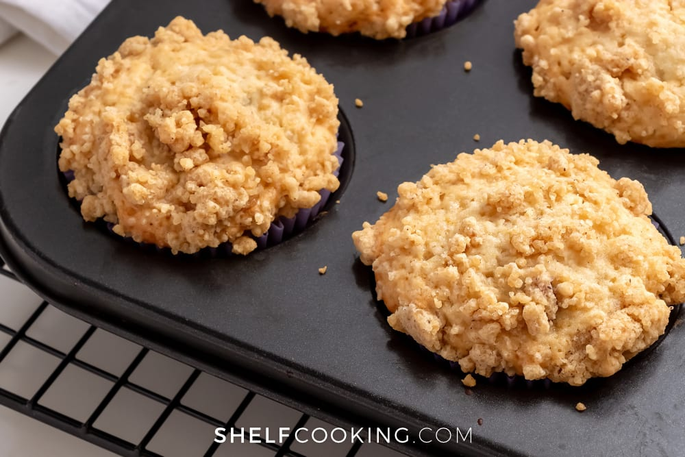 peach muffins in a tin, from Shelf Cooking