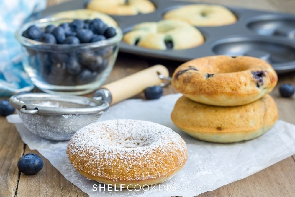 taking homemade donuts out of baking mold, from Shelf Cooking