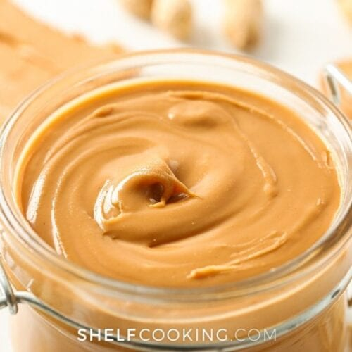 Homemade peanut butter in a jar from Shelf Cooking.