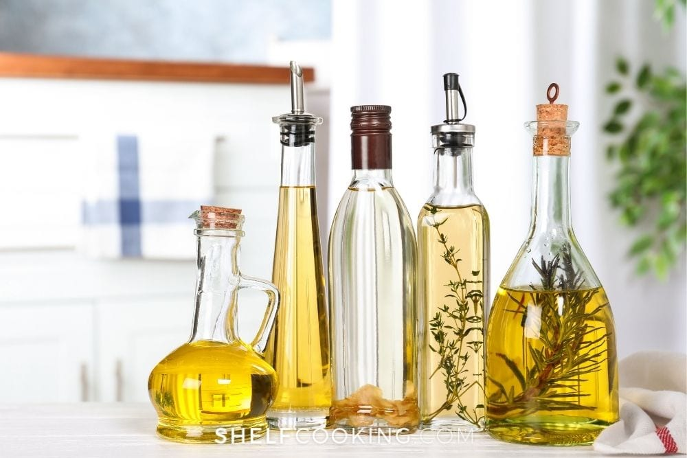 Different types of cooking oils in bottles from Shelf Cooking.