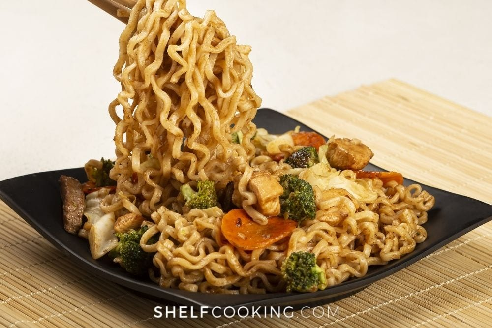 Stir fried ramen on a plate with veggies from Shelf Cooking.