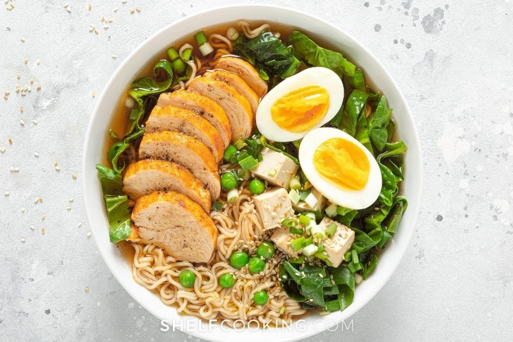 Bowl of ramen with chicken and eggs from Shelf Cooking.