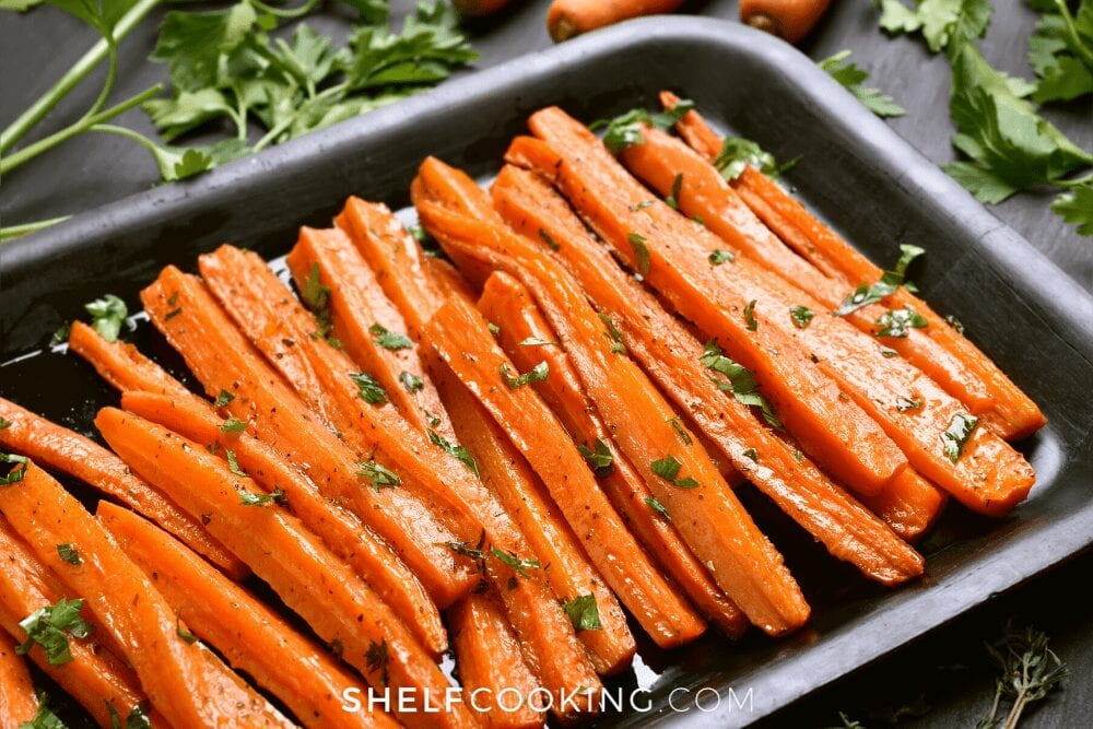 Oven roasted carrots on a cooking sheet from Shelf Cooking.